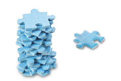 A stack of puzzles on a white background. Royalty Free Stock Photos