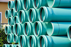 Stack of PVC water pipes. Stack of blue plastic PVC water pipe to be used in a new development of residental area Royalty Free Stock Image