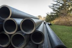 Stack of PVC water pipes Stock Image