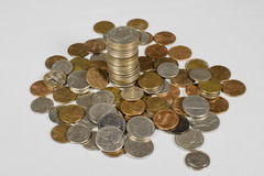 Loose Change. Stack of quarters surrounded by loose change Royalty Free Stock Images