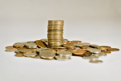 Loose Change. Stack of quarters surrounded by loose change Royalty Free Stock Photography