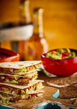 Stack of quesadillas with beer and bowl Stock Photo