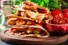 Stack of quesadillas with chicken, sausage chorizo and red peppe. R served with salsa. Mexican cuisine. Side view Royalty Free Stock Photo