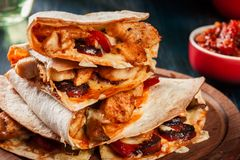 Stack of quesadillas with chicken, sausage chorizo and red peppe. R served with salsa. Mexican cuisine. Side view Royalty Free Stock Image