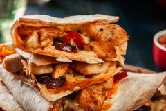 Stack of quesadillas with chicken, sausage chorizo and red peppe. R served with salsa. Mexican cuisine. Side view Stock Photo