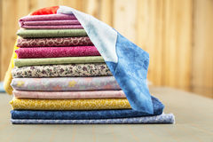 Stack of Quilt Cotton print material with a block on top Stock Photos