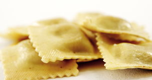 Stack of ravioli pasta. On white background stock video footage