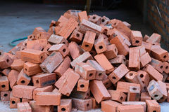 Stack of raw bricks Stock Image