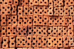 Stack of Raw hole bricks prepare for construction Royalty Free Stock Photography