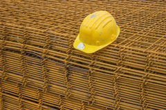 Stack of rebar grids with yellow helmet Royalty Free Stock Photo