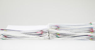 Stack of receipt overload with colorful paper clip time lapse