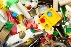 Stack of recycling garbage - glass, metal, plastic and paper Stock Photos