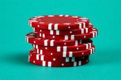Stack of Red. Red poker chips on a green background Royalty Free Stock Images