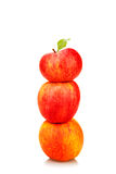 Stack of red apples with green leaf Stock Photo