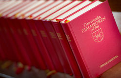 Stack of red bible books in church. Sweden, Europe Stock Photo