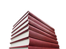 Stack of red books on white background. High stack of red books on white background isolated Royalty Free Stock Photography