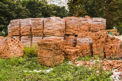 Stack of red brick for construction. Common quality building bricks stacked ready for use. stock images