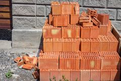 stack of red brick : masonry brick wall work detail Royalty Free Stock Image