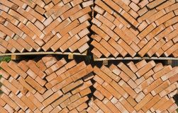 Stack of red bricks as a background or texture. stock photos