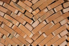 Stack of red bricks as a background or texture. stock photography