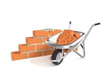 Stack of red bricks and a hand cart. Isolated on white background Royalty Free Stock Images