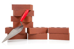 Stack of red bricks on white Royalty Free Stock Photo