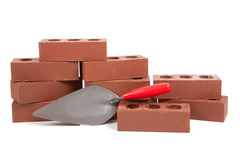 Stack of red bricks on white Stock Photography