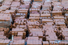 Stack of red bricks on white Royalty Free Stock Photos