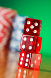Stack of red casino dice against  background Stock Photos