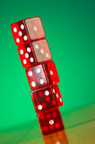 Stack of red casino dice against gradient Royalty Free Stock Images