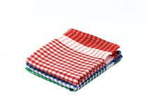 Kitchen napkin isolated. Stack or of red checkered napkin. Pile of tablecloth. Stacked towel Stock Photography