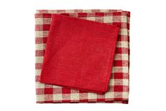 Stack of red and checkered textile napkins on white stock photo