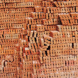 Stack of red clay brick Stock Photos