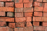 Stack red clay bricks Stock Photos