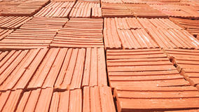 Stack of red clay bricks Royalty Free Stock Image