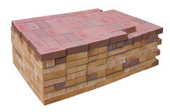 Stack of red clay bricks isolated Royalty Free Stock Images