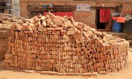A stack of red clay bricks in Kathmandu, Nepal stock photo
