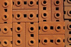 Stack of red clay bricks Stock Image