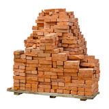 Stack of red clay bricks on white background. A stack of red clay bricks isolated on a white background Stock Photos