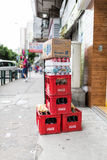 Stack of red Coca Cola crates. With coca cola soft drink and other brands. Standing on the streets of Macau. Coca Cola is one of the world`s most consumed soda Royalty Free Stock Photography