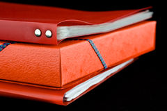Stack red file folders. A stack of red file folders, on a black background royalty free stock photo