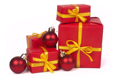 Stack of red gift boxes and christmas balls royalty free stock images