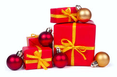 Stack of red gift boxes and christmas balls royalty free stock photography