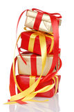 Stack of red and gold christmas presents Royalty Free Stock Images