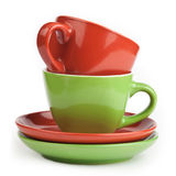 Stack of red and green tea cups and saucers Stock Photos