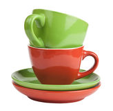 Stack of red and green tea cups and saucers Stock Photo