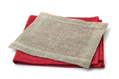 Stack of red and jute napkins on white royalty free stock images