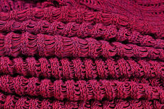Stack of red melange openwork knitted fabric Stock Photo