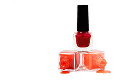 Stack of red nail polish isolated on white background stock images