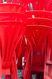 Stack of red plastic chairs Stock Images